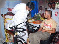 Guruji Speaking to a Person Donated with Tricycle